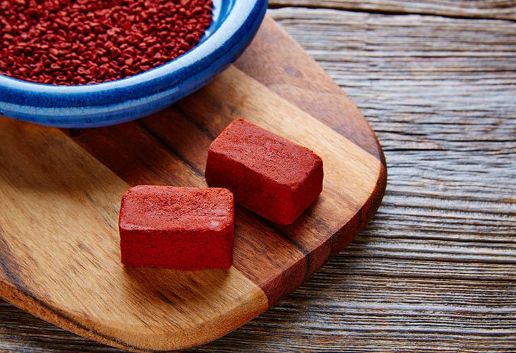 Dried annatto (achiote) seeds and paste