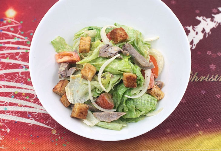 If you trim the ends of beef tongue before slicing, here's a delicious way to use those trimmings. Beef tongue salad with herbed croutons. Tasty and filling!