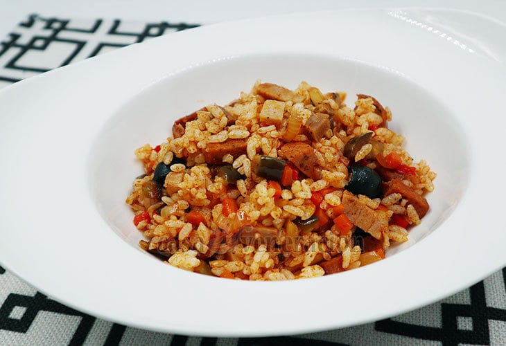 Turn holiday leftovers into this delectable Paprika Rice With Grilled Pork and Italian Garlic Sausages