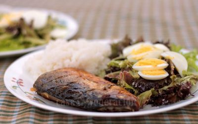 A breakfast plate of tinapang bangus (smoked milkfish), salad, egg and rice