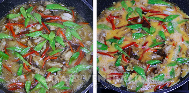 Chicken, snow peas, bell pepper and eggs in pan cooking in dashi, soy sauce, sake and mirin