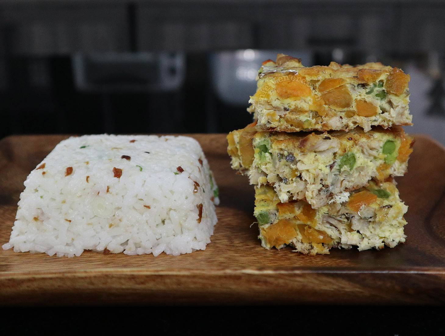 Tortang isda (fish torta) served with garlic and scallion fried rice