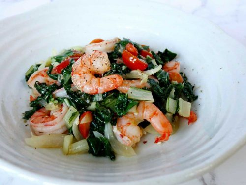 Shrimp and pachay guisado in white stoneware bowl