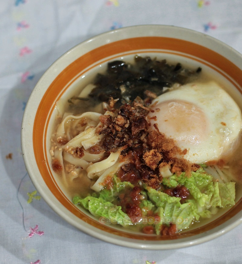 Miso noodle soup with poached egg topped with pork floss and fried shallots
