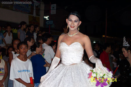 casaveneracion.com a white feathery gown with a full skirt